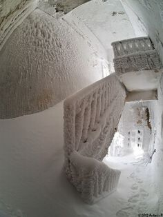 Photographer Voreas captured these striking images of an abandoned building completely consumed by snow and ice after climbing Mount Ossa (also known as Kissavos) in the Thessaly region of Greece. The building, described by some Flickr users (not surprisingly) as an ice-house and by others as the 'refuge', is attached to a small tower structure and may have served as a scientific research station.