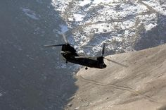 A U.S. Army CH-47 Chinook helicopter from Combined Joint Task Force 76 flies over the mountains north of Bagram, Afghanistan, Jan. 26, 2007