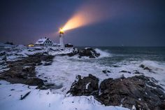 The beacon at Portland Head Light is clearly visible in the falling snow in this shot of a winter storm at twilight by our director of photography.  Get our weekly Snapshot: downeast.com/email