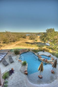 Balcony view of the pool and lake