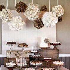 So classic vintage!  Love the colors.  brown/white/cream dessert table with puffy spheres hanging above