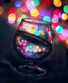 I love how the colorful lights in the background shows in the glass, and then the rest of the image is darker.