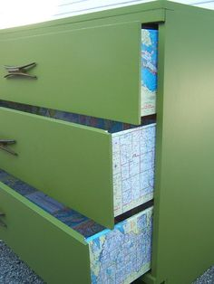 decoupaged maps on the inside of drawers