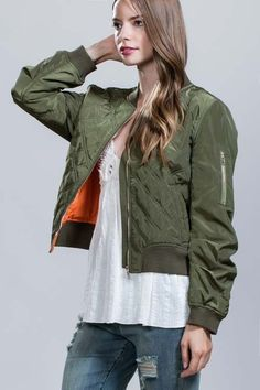 Green bomber jacket with orange lining