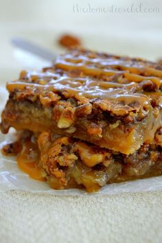 Salted Caramel Pecan Pie Bars- These gooey bars start with sugar cookie dough and get better from there! They taste like pecan pie, but in individual bar form.