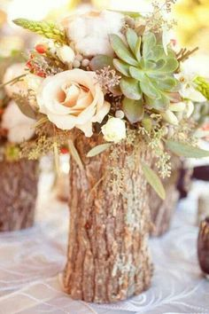 Tree Bark centerpiece with pastel flowers and succulent | Sorbet - Floral Design Trend 2016
