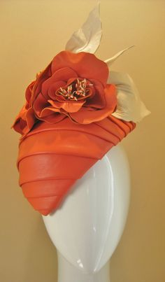 Devine in coral. A full leather pleated hand formed piece finished with 3 oversized leather flowers and cream leather leaves.