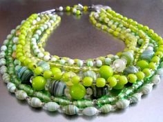 Hey, I found this really awesome Etsy listing at https://www.etsy.com/listing/215086402/green-art-glass-bib-necklace-8-row-multi
