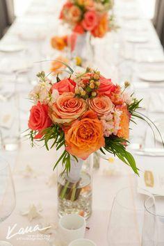 Coral wedding table flowers: Dellables Floral Wedding Design