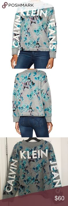 Calvin Klein Jeans Gray Floral Logo Sweatshirt This sweatshirt is a champion among street style looks. This relaxed cotton blend blooming design is printed with the Calvin Klein jeans signature logo across the sleeves and front. Soft cozy material 60% cotton 40% polyester. Calvin Klein Tops Sweatshirts & Hoodies