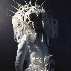 """Modeconnect.com - Joshua Harker's  3d printed """"Quixotic Divinity"""" headdress, inspired by traditional Native American, Latin, African, & Asian headdresses & masks."""