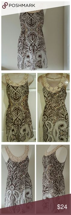 "Free People Brown & Tan Dress FREE PEOPLE Above the knee dress with scoop neckline. Discreet side zipper. All natural hues and beautiful detail in the neckline and shoulder straps. 100% Cotton  Flat Measurements (approx):  37"" Relaxed Bust  16"" Flat Waist  33"" Length  Pre-loved, very good condition. Only flaw is easily fixable & shown in pic 4 where a little thread came loose on shoulder strap. Free People Dresses"