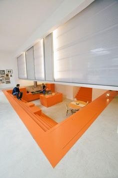 This is the latest interior design project by Doepel Strijkers and LEX Architects. This time they worked on the transformation of a former ambulance garage into a house, named Parksite. Design Thinking, Garage Transformation, Architecture Design, Orange Architecture, Desk Layout, Orange Kitchen, Commercial Interiors, Beautiful Kitchens, Office Interiors