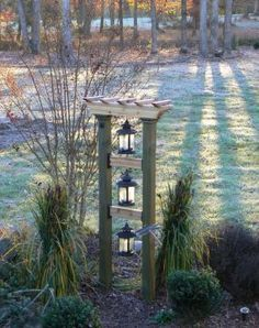 Tower of lights. Add solar lanterns and you have a summertime eye catcher in your garden. Replace with bird feeders during winter time and you'll create a bird magnet.
