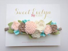 This sweet felt flower halo crown on braided jute twine with light olive green leaves is a must have for all the little girls in your life!
