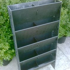 Clearly there are many types of verticle wall planters this is an Easiwall half panel, gives you an idea of how they work.