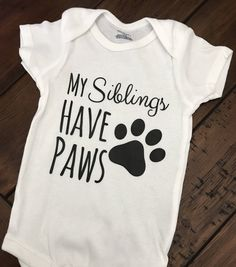 A personal favorite from my Etsy shop https://www.etsy.com/listing/516061448/my-siblings-have-paws-onesie-dog-onesie