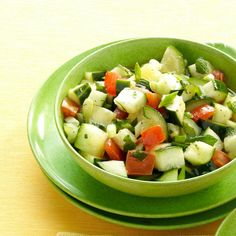 Minted Cucumber Salad Recipe -Fresh herbs and a light vinaigrette season the garden-fresh cucumbers and tomatoes in this easy salad. I'm a busy pastor's wife and mother and am always looking for new recipes that can be prepared quickly but don't sacrifice taste or nutrition. —Debbie Purdue, Westland, Michigan