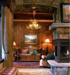 Wow!  This is a gorgeous rustic room.  Check out the rock detail on the ceiling separating the fireplace to the den.  This looks just like a house @brandi dickerson would design