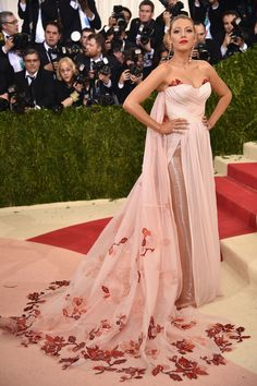Now this is a woman with class Blake Lively in a Burberry gown and Lorraine Schwartz earrings