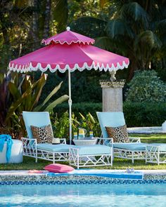 Outdoor poolside style with light blue, hot pink, leopard print and white painted bamboo frames.