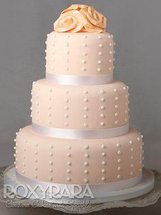 www.RoxyRara.com  Three tier soft peach wedding cake with edible pearls and handmade sugar roses.   To book in for a wedding cake tasting and consultation, email: cake@RoxyRara.com