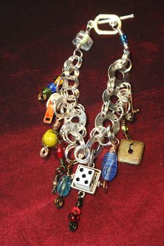 I like the mix of things and the upcycled elements in this bracelet  by jodinobles on Etsy.