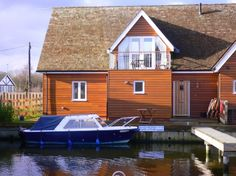 Sleeps 6 - A beautifully presented 3 bedroom waterside pine clad house with mooring and superb views of the marina from the south facing first floor lounge and balcony. Boat available to hire with property. More Details: http://www.riverside-rentals.co.uk/NorfolkHolidayCottages/marshmere