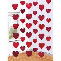 Decorate for your next party with a touch of love! The candy hearts foil string decoration puts bright red foil hearts hanging from a window, door, light or even ceiling. The package includes 6 string