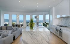 Modern kitchen with white European cabinets and marble counter