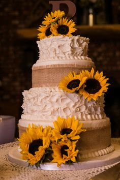 My wedding Cake! Buttercream frosting, burlap, fresh sunflowers and a wooden initial topper