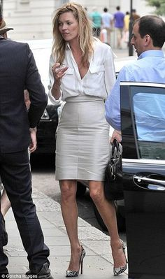 Kate Moss wearing Kate Moss for Longchamp Gloucester Bag in Black Christian Louboutin Pigalle Pumps in Roccia Python STELLA MCCARTNEY Satin-twill pocketed blouse
