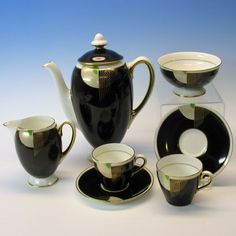 Doulton deco: Tango coffee for two set, c1930s. Black colourway - gold/white/green on black background with gold gilt trim. Classic deco at it's best, love!