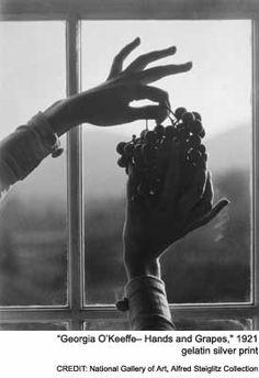 Steiglitz photo of Georgia O'Keefe's hands with grapes
