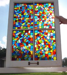 "This 4 pane window was designed with handfuls of confetti dancing in the air as my inspiration. The vibrant rainbow of colors cast an amazing pattern anywhere you choose. The wooden casing is white. It is titled: ""Confetti"" We make our mosaic windows by gluing the stained glass to the original glass. Shop: ARTful Salvage"