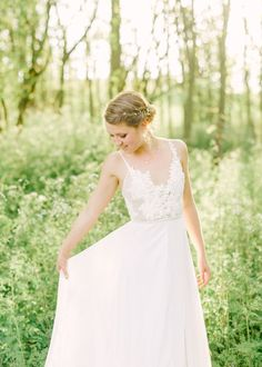 Image by Hannah Duffy Photography - A delicate Kobus Dippenaar bridal gown and a Twigs and Honey headpiece for a elegant literature themed wedding at Long Barn, Childerley Hall by Hannah Duffy Photography.