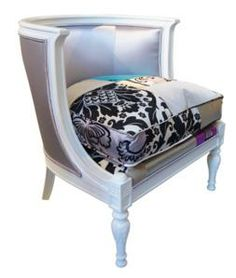 A vintage style chair that is upholstered in silky shiny fabric with a bulky cushioned seat. Its attractive look would make a difference in any interior.
