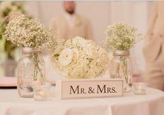 Sweetheart table with Mason jars