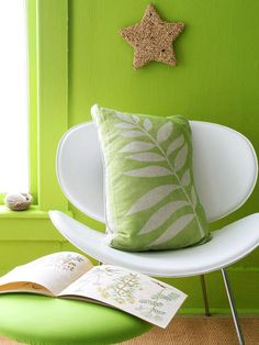 Create a large foliage stencil from contact paper, and attach it to the material using tape and straight pins. Spray bright green fabric paint over the surface of the pillow, let it dry, then peel back the stencil to reveal the design.