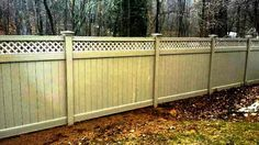 Vinyl Privacy Fencing with a diagonal lattice topper