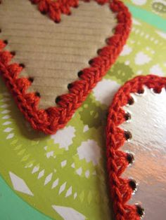 Cardboard hearts with crochet border.