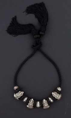 India | High silver content amulet necklace from Orissa | ca. beginning of the 1900s I think this would be an awesome way to incorporate rings into a design--