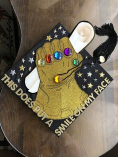 Struggling to figure out how to decorate a graduation cap? Get some inspiration from one of these clever DIY graduation cap ideas in These high school and college graduation cap decorations won't disappoint! Disney Graduation Cap, Funny Graduation Caps, Graduation Cap Designs, Graduation Cap Decoration, Graduation Diy, Funny Grad Cap Ideas, Super Glue, Grey's Anatomy, Captain America