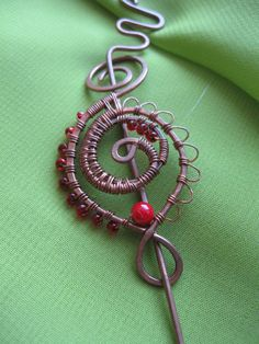Very cool!   Hey, I found this really awesome Etsy listing at https://www.etsy.com/listing/93839110/whimsical-ornate-wire-wrapped-shawl-pin