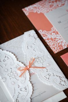 Tangerine and doily invites. Minted. Photography by lauraashbrook.com, Floral Design by floraloccasions.com