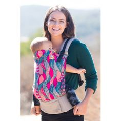 Tula Baby - Ergonomic Carrier - Cheshire This Tula Baby Carrier has an intricate pattern and bright unique colors that bring an unexpected playful spirit to the season! 'Cheshire' was inspired by the mischievous cat from Alice in Wonderland!