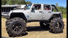 Don't think I've ever seen a JK with tractor tires before. Has me wondering how the jeep's motor could hold up to mudding with such huge meats.