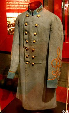 Confederate Infantry Officer's Frock Coat. Grey wool double breasted coat with blue collar and cuff facings for Infantry. Three gold bullion bars on each side of collar and two rows of gold bullion braid on each sleeve indicate rank of Captain. Classic example of a regulation CSA Infantry Captain frock coat.