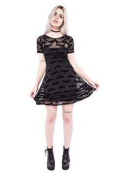 Halloween dreams in the summer sun _ this LBD is every little goth girls dream. Short-sleeved dress with a full skater skirt, collar feature and mesh fabric pan