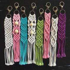 Handmade macrame keychain made with a natural 100% cotton rope. Each keychain measures approximately 11 inches from top of keychain to the bottom of the fringe.